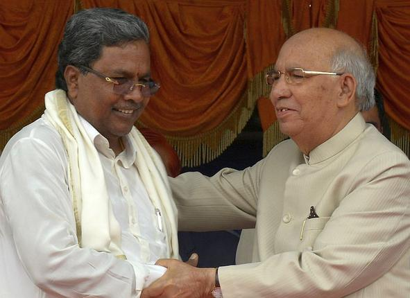 Karnataka Governor H.R. Bhardwaj greets Chief Minister Siddaramaiah after the swearing-in ceremony at Kanteerava Stadium in Bangalore on Monday. Photo: K . Bhagya Prakash,The Hindu