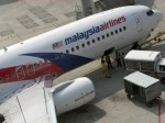 Terror theory for missing Malaysian jet; floating door spotted