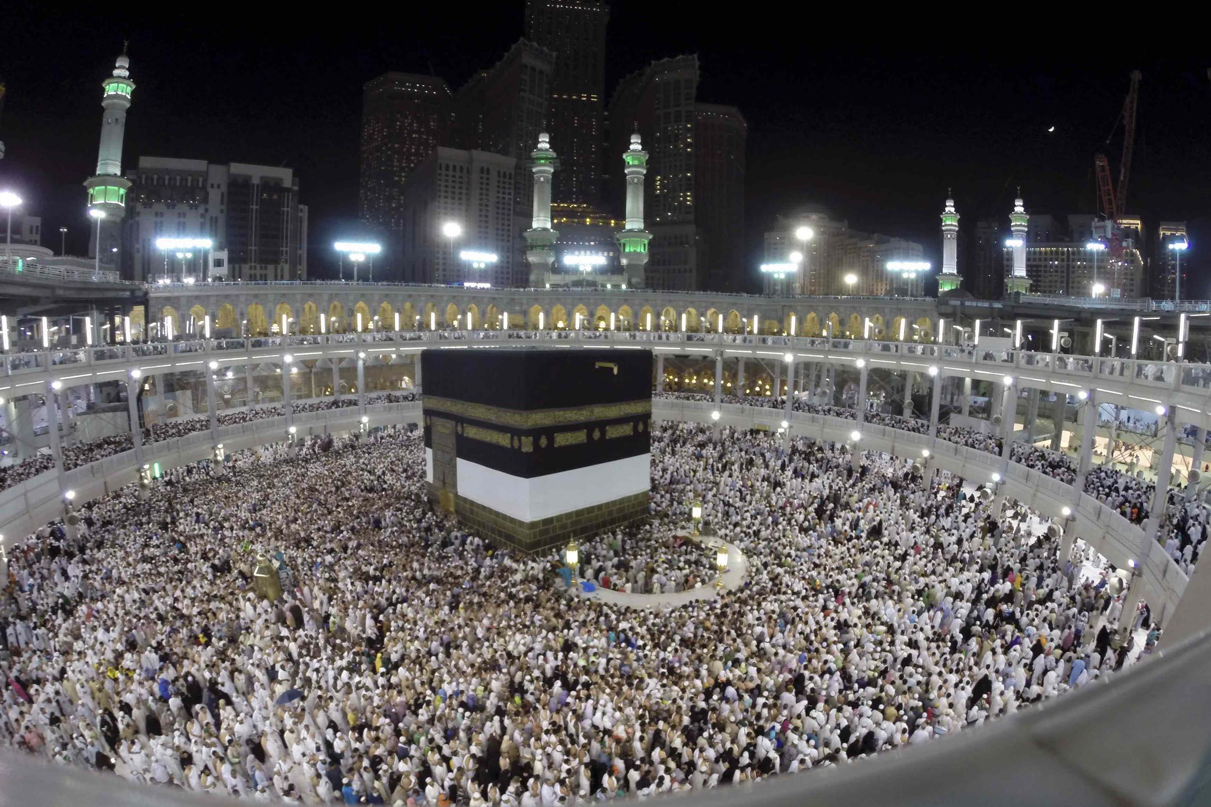 Muslim Pilgrims Pray Around The Holy Kaaba At The Grand