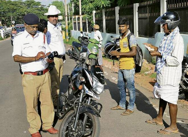 New Traffic Rules 1k fine for without hallmark helmets